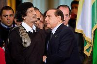 Silvio Berlusconi during the press conference with Libya's leader Muammar Gaddafi at Villa Madama in Rome June 10, 2009
