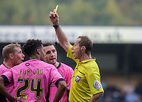 Nicky Adams of Northampton Town argues as Darnell Furlong (Loanee from QPR) of Northampton Town is shown yellow by Referee Keith Hill during the Sky Bet League 2 match between Wycombe Wanderers and Northampton Town at Adams Park, High Wycombe, England on 3 October 2015. Photo by Andy Rowland.