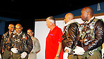 Buffalo Bills Rex Ryan (head coach NFL's Buffalo Bills) is presented an award by Black Angels' Over Tuskegee Melvin Huffnagle (3rd left - home town is Buffalo) as castmates watch L to R: Delano Barbosa, Melvin Huffnagle, Craig Colasanti, Layon Gray, Rex Ryan, David Roberts - cast which performed a private performance for Buffalo Bills' head coach Rex Ryan and the team players on September 8, 2015 at Shea Performing Arts Center, Buffalo, New York. (Photo by Sue Coflin/Max Photos)