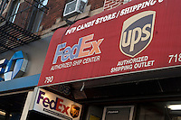 A FedEx and UPS logo is pictured on a store in New York City, NY Monday August 1, 2011.