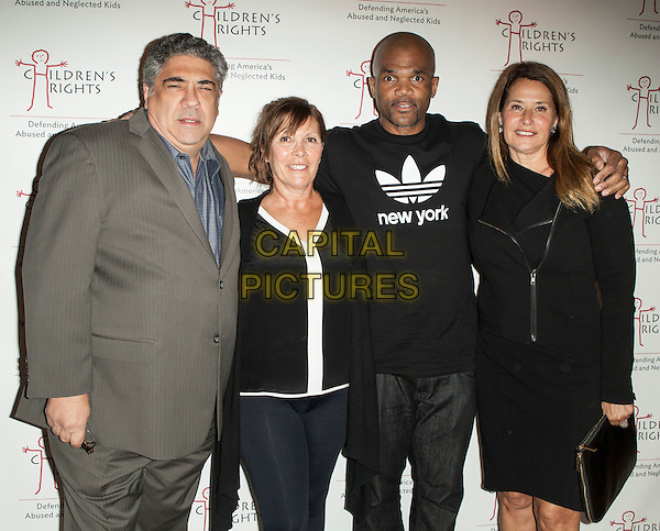 Vincent Pastore, Sheila Jaffe, Darryl 'D.M.C.' Matthews McDaniels and Lorraine Bracco <br /> attend the 8th Annual Children's Rights Charity Event at the Four Seasons Restaurant, New York City, NY., USA.<br /> October 7th, 2013 <br /> half length dress green purple sleeveless dress black bag purse beige suit jacket<br /> CAP/MPI/COR<br /> &copy;Corredor99/ MediaPunch/Capital Pictures