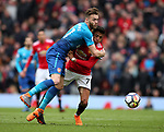 Callum Chambers of Arsenal gets to grips with Alexis Sanchez of Manchester United during the premier league match at the Old Trafford Stadium, Manchester. Picture date 29th April 2018. Picture credit should read: Simon Bellis/Sportimage