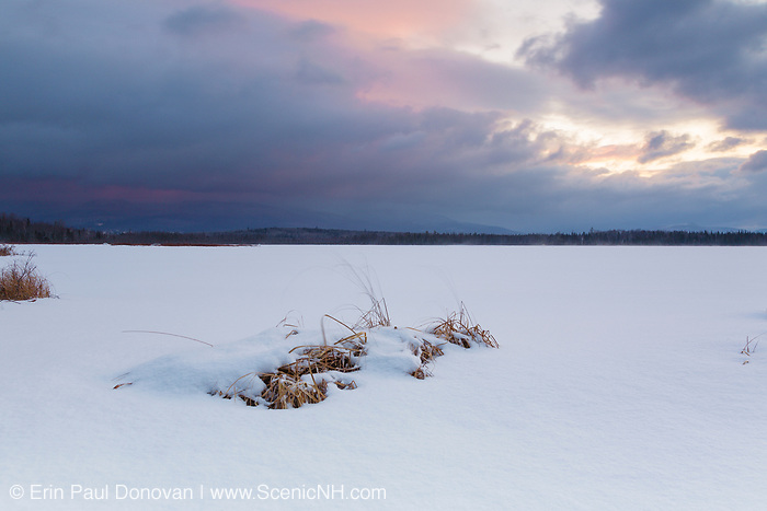 Pondicherry Wildlife Refuge - Sunrise from Cherry Pond during stormy weather (snow storm) in Jefferson, New Hampshire during the winter months.