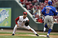 03 April 2006: Cincinnati Reds' Scott Hatteberg, left, makes a play against Chicago Cubs' Juan Pierre during the Reds' home opener at Great American Ballpark in Cincinnati, Ohio.<br />