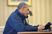 United States President Barack Obama speaks on the phone with US Secretary of Health and Human Services Sylvia Burwell, to get an update on the response to the Ebola diagnosis in Dallas, in the Oval Office of the White House in Washington DC, USA, 12 October 2014.<br /> Credit: Michael Reynolds / Pool via CNP