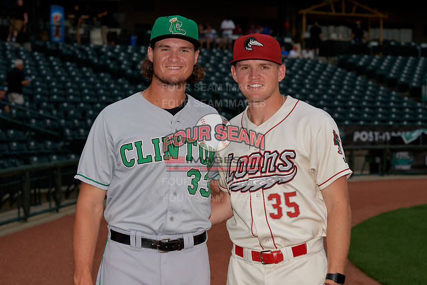 Clinton LumberKings pitcher Tyler Kolek (33) poses for a photo with his brother, Great Lakes Loons pitcher Stephen Kolek (35), before a Midwest League game on July 19, 2019 at Dow Diamond in Midland, Michigan.  Clinton defeated Great Lakes 3-2.  (Mike Janes/Four Seam Images)