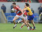 Aidan Walsh of Cork in action against Shane Brennan of Clare during their National Football League game at Cusack Park. Photograph by John Kelly.