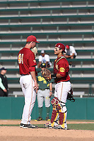 Jeremy Martinez (2) of the Southern California Trojans talks with pitcher Jeff Paschke (44) during a game against the Oregon Ducks at Dedeaux Field on April 18, 2015 in Los Angeles, California. Oregon defeated Southern California, 15-4. (Larry Goren/Four Seam Images)