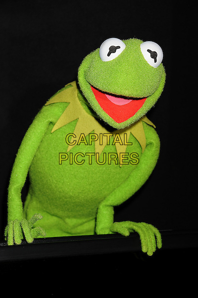 """Kermit the Frog.""""The Muppets"""" Los Angeles Premiere held at the El Capitan Theatre, Hollywood, California, USA..November 12th, 2011.green costume  mouth open atmosphere .CAP/ROT/TM.©Tony Michaels/Roth Stock/Capital Pictures"""