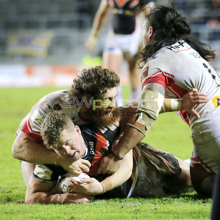 PICTURE BY CHRIS MANGNALL /SWPIX.COM...<br /> Rugby League - Super League - St Helens Saints v Castleford Tigers   - Langtree Park Stadium, , England  - 04/03/16<br /> St Helens Kyle Amor and Atelea Vea  fail to stop  Castleford's Adam Milner  scoring a try