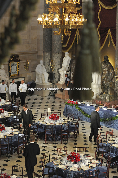 Servers prepare for the inaugural luncheon as security performs one last security sweep following Barack Obama's swearing in as the 44th President of the United States at Statuary Hall in the U.S. Capitol in Washington, DC on January 20, 2009.
