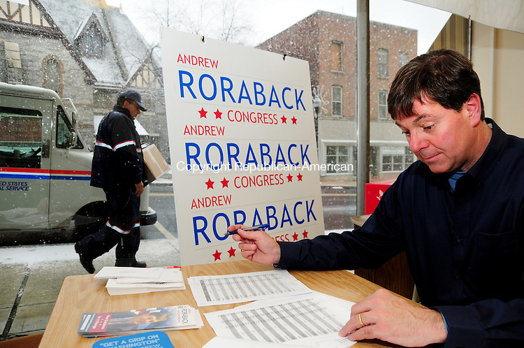 TORRINGTON, CT, 07 NOV 12-11072AJ01- Sen. Andrew W. Roraback, R-Goshen, on Wednesday in his Torrington campaign office that he is about to close, reviews polling numbers from the 5th Congressional District election, which he lost to Democrat Elizabeth Esty of Cheshire.  Alec Johnson/ Republican-American