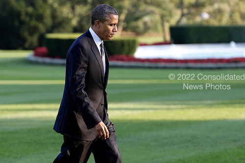 United States President Barack Obama walks to the Oval Office as he returns to the White House in Washington, D.C., U.S., on Friday, October 5, 2012. Obama was returning from a campaign trip to Virginia and Ohio. .Credit: Joshua Roberts / Pool via CNP