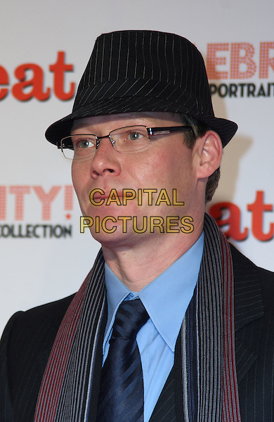 RICKY GROVES .'Celebrity! - the Heat Portrait Collection' Private View held at the Brunswick Gallery, London, England..November 26th, 2009.headshot portrait black hat glasses  blue striped stripes scarf .CAP/JIL.©Jill Mayhew/Capital Pictures