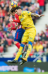 Alejandro Galvez Jimena (R) of UD Las Palmas fights for the ball with Antoine Griezmann of Atletico de Madrid during the La Liga 2017-18 match between Atletico de Madrid and UD Las Palmas at Wanda Metropolitano on January 28 2018 in Madrid, Spain. Photo by Diego Souto / Power Sport Images
