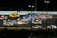 Jul. 2, 2011; Daytona Beach, FL, USA; NASCAR Sprint Cup Series drivers Mark Martin (5), Martin Truex Jr (56), Kurt Busch (22), Clint Bowyer (33), Joe Nemechek (87), Landon Cassill (51), Regan Smith (78), Tony Stewart (14) and Brian Vickers (83) crash as Dale Earnhardt Jr (88) goes low to avoid during the Coke Zero 400 at Daytona International Speedway. Mandatory Credit: Mark J. Rebilas-