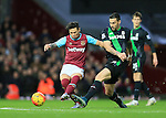 West Ham's Mauro Zarate tussles with Stoke's Geoff Cameron<br /> <br /> Barclays Premier League - West Ham United v Stoke City - Upton Park - England -12th December 2015 - Picture David Klein/Sportimage
