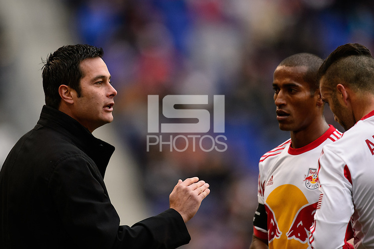 New York Red Bulls head coach Mike Petke talks with Roy Miller (7) and Armando (5). The New York Red Bulls and Chivas USA played to a 1-1 tie during a Major League Soccer (MLS) match at Red Bull Arena in Harrison, NJ, on March 30, 2014.