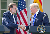 United States President Donald J. Trump, right, and President of the Government or Prime Minister Mariano Rajoy of Spain, left, shake hands as they conduct a joint press conference in the Rose Garden of the White House in Washington, DC on Tuesday, September 26, 2017.<br /> Credit: Ron Sachs / CNP