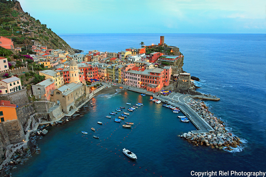 "Vernazza is one of the five towns that make up the Cinque Terre region. Vernazza is the fourth town heading north, has no car traffic, and remains one of the truest ""fishing villages"" on the Italian Riviera."