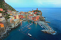 """Vernazza is one of the five towns that make up the Cinque Terre region. Vernazza is the fourth town heading north, has no car traffic, and remains one of the truest """"fishing villages"""" on the Italian Riviera."""