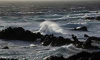 Waves crashing on the rocks near the light house ( Faro de Abona) south Tenerife, Canary Islands, Spain