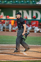 Umpire Matt Herrera handles the calls behind the plate during a game between the Ogden Raptors and the Orem Owlz at Lindquist Field on August 3, 2018 in Ogden, Utah. The Raptors defeated the Owlz 9-4. (Stephen Smith/Four Seam Images)