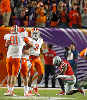 Ohio State Buckeyes quarterback Braxton Miller (5) takes a knee after throwing an interception to Clemson Tigers during the 3rd quarter in the Discover Orange Bowl at Sun Life Stadium in Miami Gardens, Florida on January 3, 2014.(Dispatch photo by Kyle Robertson)