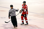 February 22nd 2008:  Matt Kinch (2) of the Binghamton Senators gets the game puck from linesman Michael Baker after a game vs. the Rochester Amerks at Blue Cross Arena at the War Memorial in Rochester, NY.  The Senators defeated the Amerks 4-0.   Photo copyright Mike Janes Photography