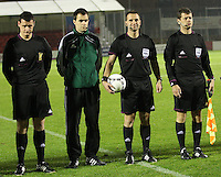 Match officials (left to right) Gavin Harris (Ass Referee 2), Don Robertson (4th Official), Jan Valasek (Referee) and Tomas Vorel (Ass Referee 1) in the Armenia v Switzerland UEFA European Under-19 Championship Qualifying Round match at New Douglas Park, Hamilton on 11.10.12.