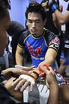 Hiroshe Tanaka, All-Japan combat wrestling Champion, gets his hands bandaged up<br /><br />MMA. Mixed Martial Arts &quot;Tigers of Asia&quot; cage fighting competition. Top professional male and female fighters from across Asia, Russia, Australia, Malaysia, Japan and the Philippines come together to fight. This tournament takes place in front of a ten thousand strong crowd of supporters in Pelaing Stadium. Kuala Lumpur, Malaysia. October 2015