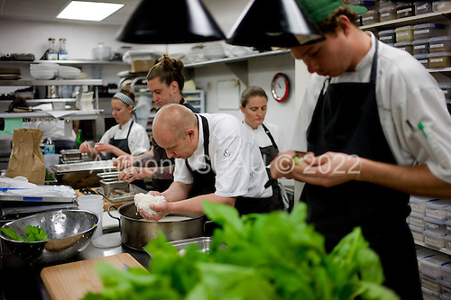 Charleston, South Carolina<br /> October 24, 2013<br /> <br /> 17 internationally renowned chefs, attending the Cook It Raw event in Charleston, begin preparing for a collective dinner in McCrady's restaurant kitchen.<br /> <br /> Sasu Laukkonen, chef and sommerier at restaurant Eira in Helsinki, Findland, prepares his dish to his right is chef Brandon Baltzley from the restaurant TMIP in Laporte County, Indiana and behind him is chef April Bloomfield from the restaurant The Spotted Pig, New York City.