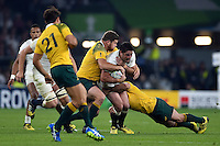 Brad Barritt of England is double-tackled. Rugby World Cup Pool A match between England and Australia on October 3, 2015 at Twickenham Stadium in London, England. Photo by: Patrick Khachfe / Onside Images