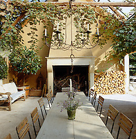 An outdoor dining area furnished with a long table where the vineyard workers  relax and share meals toegther