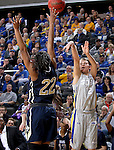 SIOUX FALLS, SD - MARCH 9: Macy Miller #12 of SDSU puts up a shot against Jordan Gilbert #22 of Oral Roberts in the first half of their semi-final round Summit League Championship Tournament game Monday afternoon at the Denny Sanford Premier Center in Sioux Falls, SD. (Photo by Dick Carlson/Inertia)