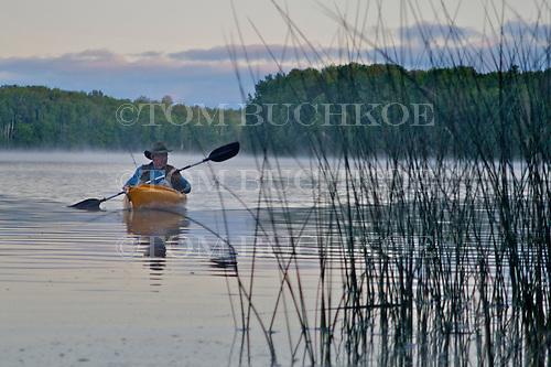 Fisherman in kayak on Moccasin Lake in Alger county near Munising in Michigan's Upper Peninsula.