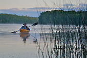 Fisherman in kayak on Moccasin Lake in Alger county near Munising in Michigan's Upper Peninsula.