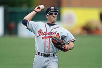 Center fielder Joseph Daris (11) of the Rome Braves warms up before a game against the Greenville Drive on Sunday, June 14, 2015, at Fluor Field at the West End in Greenville, South Carolina. Rome won, 5-2. (Tom Priddy/Four Seam Images)