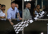 David Beckham waves the chequered flag during the Bahrain Grand Prix at Bahrain International Circuit, Sakhir,  on 31 March 2019. Photo by Vince  Mignott.