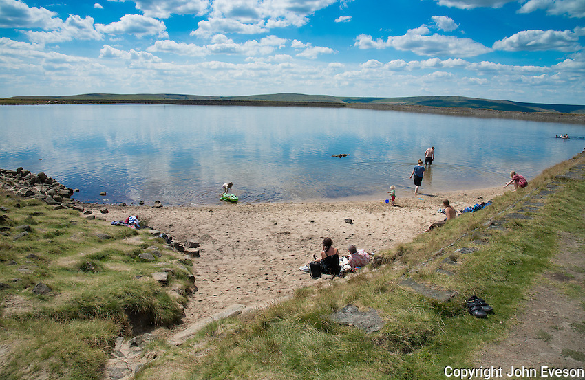 Gaddings Dam reservoir, Todmorden, West Yorkshire. A disused reservoir featuring a small sandy beach 60 miles from the coast and 780ft above sea level which has become a popular swimming spot.