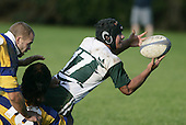 C. Luteru gets his pass away in the tackle of M. Sa'u. Counties Manukau Premier Club Rugby, Patumahoe vs Manurewa played at Patumahoe on Saturday 6th May 2006. Patumahoe won 20 - 5.