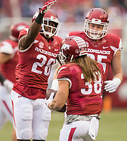 Hawgs Illustrated/BEN GOFF <br /> Josh Liddell (28) and Jake Hall (95) celebrate with Reid Miller (38) after Miller recovered a Mississippi State fumble on an Arkansas punt in the first quarter Saturday, Nov. 18, 2017, at Reynolds Razorback Stadium in Fayetteville.