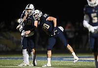 NWA Democrat-Gazette/CHARLIE KAIJO Bentonville West Nick Whitlatch (20) and quarterback Dalton Mcdonald (12) react, Friday, November 8, 2019 during a football game at Bentonville West High School in Centerton.