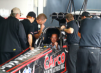 Jun 5, 2015; Englishtown, NJ, USA; A crew member look on as the engine fires up for NHRA top fuel driver Steve Torrence during qualifying for the Summernationals at Old Bridge Township Raceway Park. Mandatory Credit: Mark J. Rebilas-