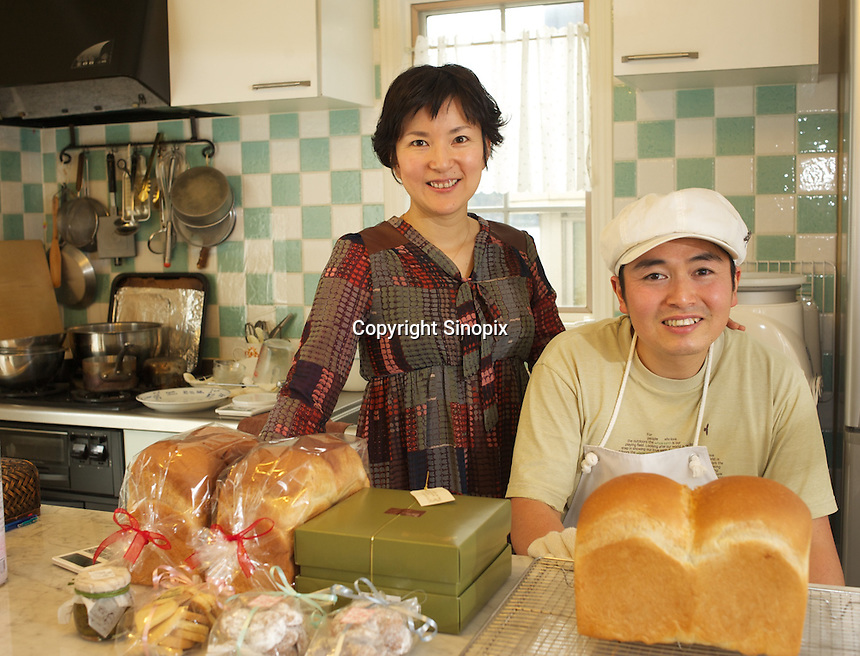 Japanese baker, Mizuki Taira, 36, and his wife Fusako,  in his home bakery called Gateau d'Ange, Kamakura, Japan 09 Feb 11. The the waiting list  for his bread is now eight years long.  Mizuki Taira, turned to baking after a nasty bicycle accident, as part of his rehabilitation.