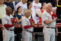 Philadelphia Phillies coaches (L to R) Juan Samuel, Sam Perlozzo, and manager Charlie Manuel stand during the national anthem before the Major League baseball game against the Houston Astros on September 16th, 2012 at Minute Maid Park in Houston, Texas. The Astros defeated the Phillies 7-6. (Andrew Woolley/Four Seam Images).