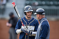 Brian Lees (16) of the Akron Zips talks to head coach Rick Rembielak during the game against the Charlotte 49ers at Hayes Stadium on February 22, 2015 in Charlotte, North Carolina.  The Zips defeated the 49ers 5-4.  (Brian Westerholt/Four Seam Images)