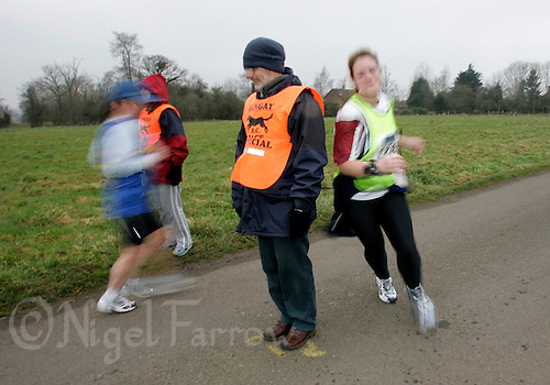 19 FEB 2006 - BUNGAY, GBR - Competitors turn during the St. Peters Brewery Great East 20k Run (PHOTO (C) NIGEL FARROW)