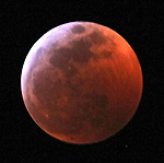 Tonight Earth will be precisely between the Sun and a Full Moon. The moon will pass first into Earth's outer shadow, and lose it luster. Then it will move into Earth's central shadow, its umbra, with the result being a red-orange-copper color moving across its surface.
