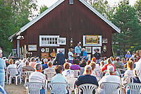 A country side auction with buyers sitting in white plastic chairs hoping for bargains. Lonneberga Smaland region. Sweden, Europe.